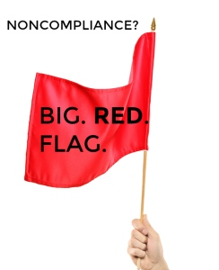 Hand waving a red flag isolated on white background