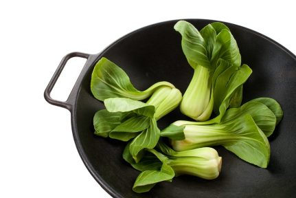cast iron wok with bok choy