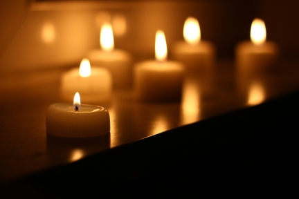 Holiday candles burning on a white background and reflected ** Note: Soft Focus at 100%, best at smaller sizes